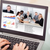 Businesswoman Video Conferencing With Laptop